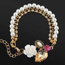 กำไลมุกคริสตัล แฟชั่นเกาหลีแต่งดอกไม้ด้วยสร้อยข้อมือหรูหรา นำเข้า สีทอง - พร้อมส่งW222 ลดราคา129บาท