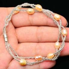 สร้อยข้อมือมุกแท้ ขนาด6.5mmสายทองคำขาว18K White Gold Genuine Pearl Bracelet นำเข้า สีส้ม - พร้อมส่งW407 ราคา990บาท
